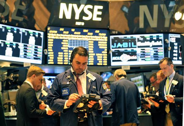 High-speed trading firms get a two-second head start on looking at the University of Michigans consumer confidence report. Above, traders at the NYSE.