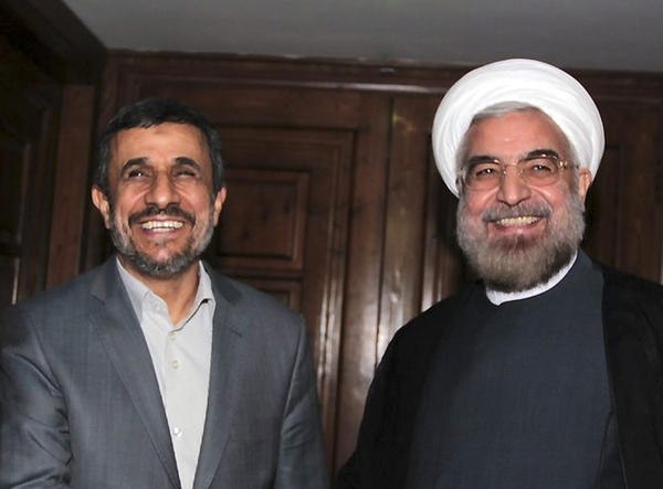 President-elect Hassan Rowhani has vowed for better ties with the world, and aims to reduce the West's sanctions against Iran over the country's disputed nuclear program. Above: Outgoing Iranian President Mahmoud Ahmadinejad, left, shakes hands with Rowhani during a meeting in Tehran, Iran.