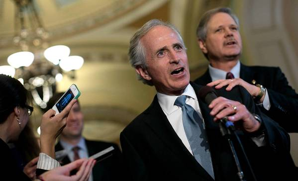 Republican Sens. Bob Corker, center, and John Hoeven helped carve out an agreement to fortify border security as part of an immigration overhaul.