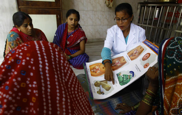 Cervical cancer can be diagnosed with a simple Pap smear in its early stages, when it is easily eradicated. Above: A health worker briefs a group of women about cervical cancer during one of her regular visits to a slum in Mumbai, India.