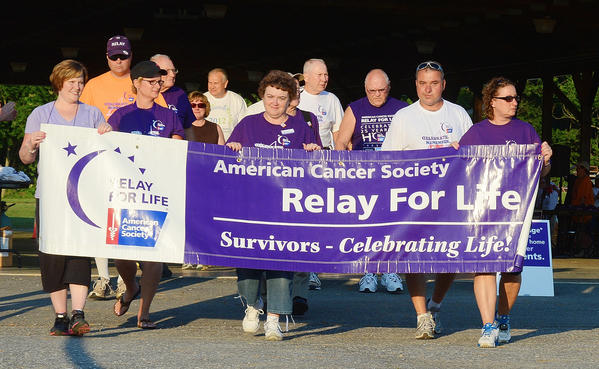 "Cancer survivors take the ceremonial ""survivors walk"" at the Relay for Life of Southern Washington County."