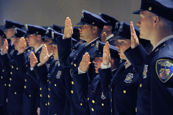 Cadets are sworn in as members of the Baltimore Police Department at the Baltimore Police Academy Class 2012-04 graduation ceremony at police headquarters.