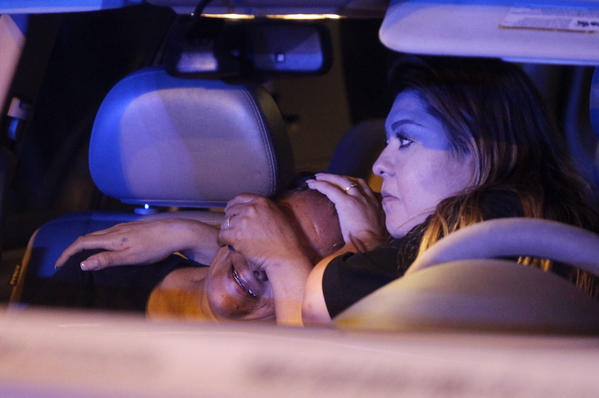 Women cry in a car while waiting to find out what hospital a shooting victim was taken to. Chicago police investigated the scene where multiple people were shot in the 2900 block of N. Kilpatrick Ave.