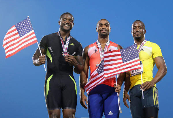 Second place finisher Justin Gatlin, winner Tyson Gay and third place finisher Charles Silmon pose together on the podium after the men's 100 meter dash final.