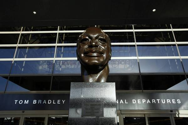 A statue of former Mayor Tom Bradley stands in front of the center entrance the LAX's international terminal.
