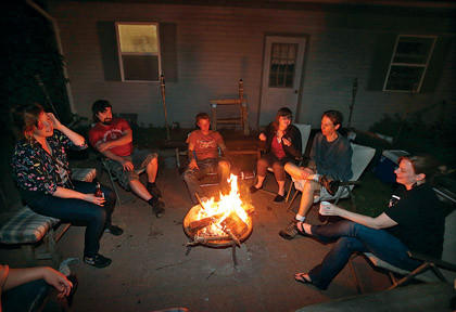 From left, Lucy Kervin, Alex Ward, Joshua Wisniewski, Tabitha DeVoss, Dan Cleberg and Angie Cleberg sit around a fire pit in the Cleberg's backyard late at night. Aberdeen officials are considering an ordinance that will put limits on outdoor fire pits.