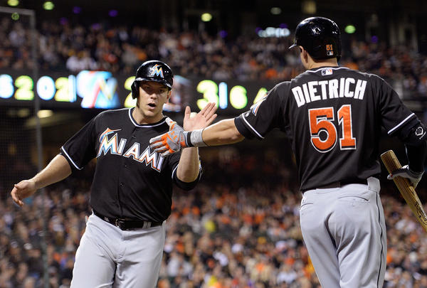SAN FRANCISCO, CA - JUNE 21: Logan Morrison #5 of the Miami Marlins is congratulated by teammate Derek Dietrich #51 after Morrison scored on an RBI single from teammate Marcell Ozuna #48 (not pictured) in the sixth inning against the San Francisco Giants at AT&T Park on June 21, 2013 in San Francisco, California. (Photo by Thearon W. Henderson/Getty Images) ORG XMIT: 163494205