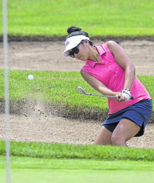 Jennifer Hong hits out of a bunker during the Four Winds Invitational at Blackthorn Golf Course in South Bend on Friday.