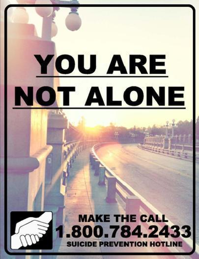 Pasadena officials plan to install signs like this one along the Colorado Street Bridge in an effort to curb suicides.
