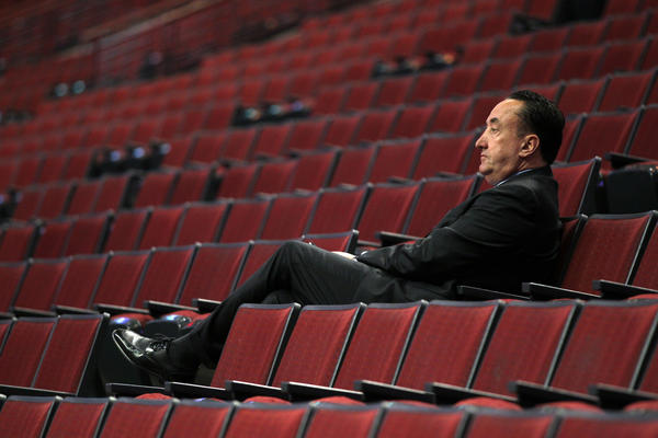 Bulls general manager Gar Forman watch his team warm up before playing the Heat in Game 3.