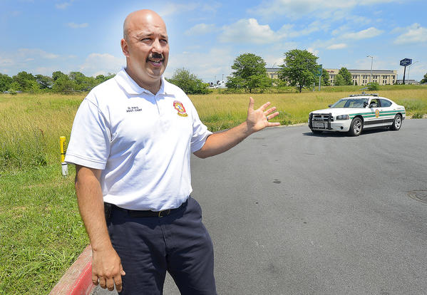 Dave Hays, Assistant Chief at Community Rescue Service, stands in front of a 3/4 acre lot at the end of Oliver Drive near I-81 and Maugans Ave. that will house an ambulance station for CRS to help service the north end of Washington County.