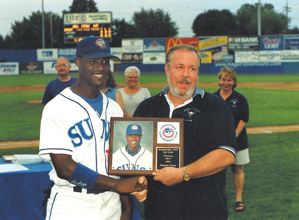 Every season, the Hagerstown Suns Fan Club gave awards to the players. Gary presents the 2000 Unsung Hero award to Suns player Shannon Carter on behalf of the fan club.