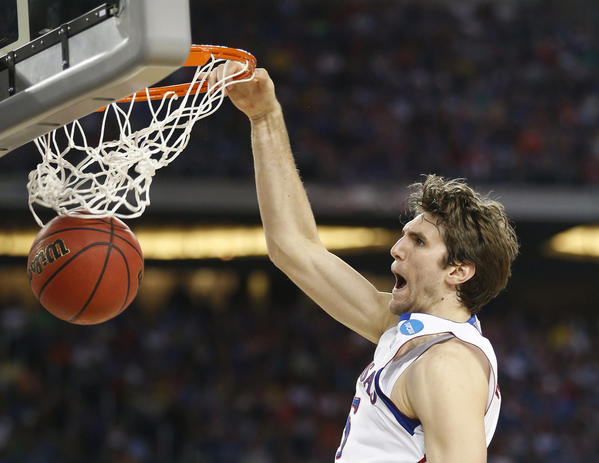 Kansas' Jeff Withey dunks in the second half against Michigan.