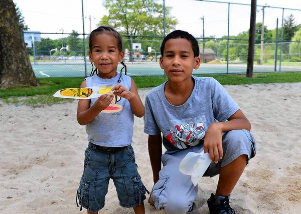 Brothers Sydon Defairia, 4 (left) and Quran Defairia, 13, both of Allentown help show us the fun that can be had with a scoop made with an empty half-gallon or gallon jug.