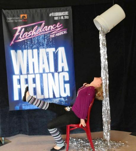 "A woman poses in an iconic image from ""Flashdance"" in the lobby at the Segerstrom Center for the Arts. The photo opportunity was one of many attractions the center's Audience Engagement Group has created to make Broadway shows more interactive."