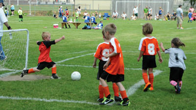 Easton Mull clears the ball from the net as teammates wait for the pass in a U6 Somerset AYSO game Saturday.