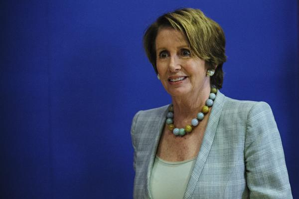 House Minority Leader Nancy Pelosi (D-San Franciso) heads to a briefing on the National Security Agency earlier in June. She was heckled by some liberal activists Saturday at a Netroots Nation conference when she said Edward Snowden broke the law when he revealed classified information about secret surveillance programs.
