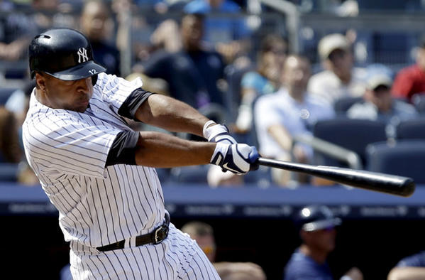 New York Yankees' Vernon Wells hits a ground-rule double to drive in three runs during the seventh inning against the Tampa Bay Rays.