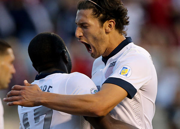 U.S. soccer national team's Omar Gonzalez, right, celebrates with Jozy Altidore after Altidore's goal against Honduras during a World Cup qualifying match.