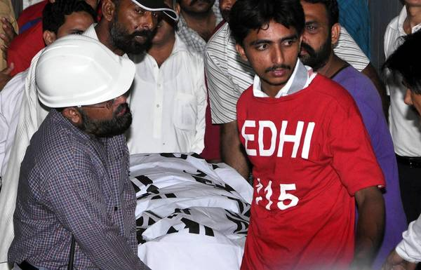 The body of Movement for Justice official Zahra Shahid Hussain is transported after she was gunned down May 18 outside her home in Karachi, Pakistan.