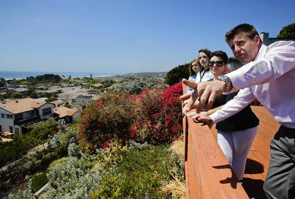 Real estate agent Ryan Mathys points out a view.