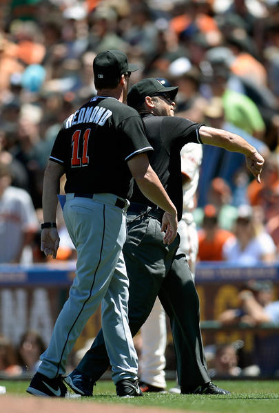 SAN FRANCISCO, CA - JUNE 22: Manager Mike Redmond #11 of the Miami Marlins is tossed out of the game by first base umpire Mark Wegner #14 after Redmond argued a ground rule double call that allowed Barry Zito #75 of the San Francisco Giants to score from first base in the fifth inning at AT&T Park on June 22, 2013 in San Francisco, California. (Photo by Thearon W. Henderson/Getty Images) ORG XMIT: 163494221