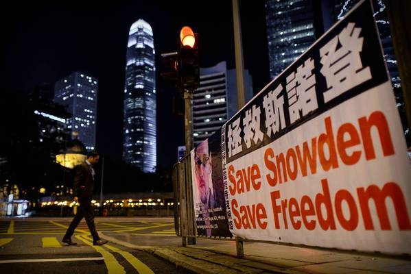A banner in Hong Kong expresses support for former U.S. National Security Agency worker Edward Snowden. The U.S. formally asked Hong Kong for his extradition.
