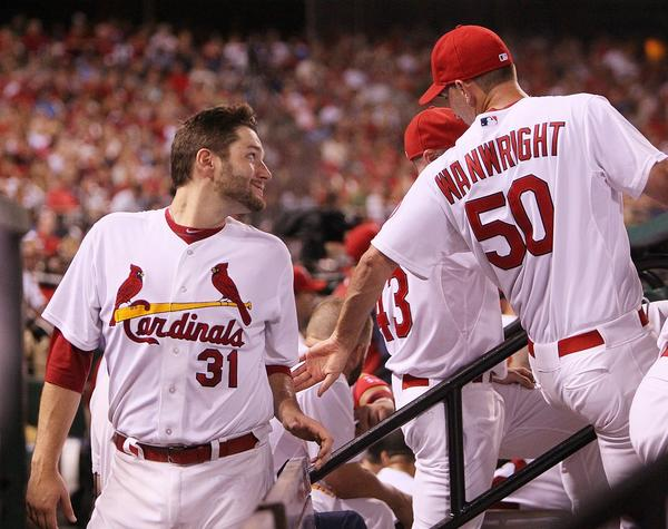 St. Louis pitcher Adam Wainwright, right, speaks with fellow starter Lance Lynn, who earned his 10th win of the season Thursday night against the Chicago Cubs.