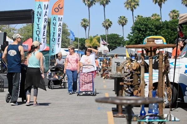 Visitors walk around the Orange County Antique Market on Saturday.