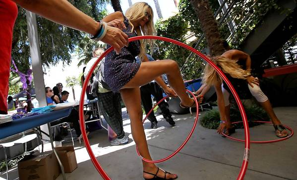People compete in a hula hoop contest at the 14th annual Trans Pride L.A. festival in Hollywood.