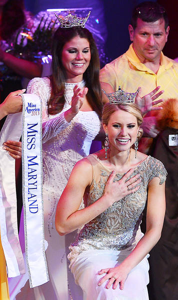 Miss Western Maryland Christina Denny is crowned Miss Maryland 2013 by outgoing Miss Maryland Joanna Guy Saturday at The Maryland Theatre in Hagerstown.
