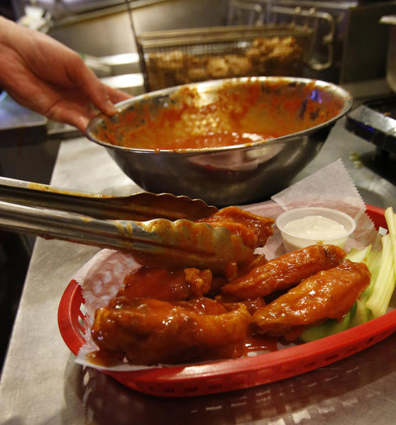 Fried chicken drums and wings are dipped in buffalo sauce are served up at the Circus Bar and Grill.