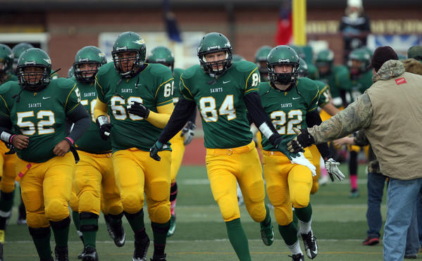 Presentation College football players take to the field before a game at Swisher Field. photo by john davis taken 10/2012