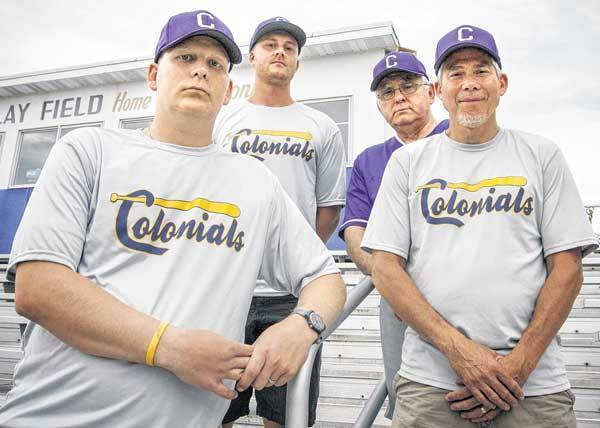 Clay baseball coach Chad Hudnall, left, stands with his coaching staff, Justin Zobrosky (from left) Dan Kasper and Bill Schell at Clay Field on Monday. Hudnall leaned on the support of the entire Clay staff to help the Colonials enjoy success this spring.