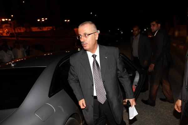 Palestinian Prime Minister Rami Hamdallah arrives at the Al Najah University in the West Bank city of Nablus after meeting Saturday with President Mahmoud Abbas in Ramallah City.