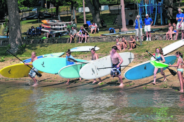 Young competitors take off in last year's Lake Max Challenge, a stand-up paddleboard race on Lake Maxinkuckee, which returns Friday and Saturday.