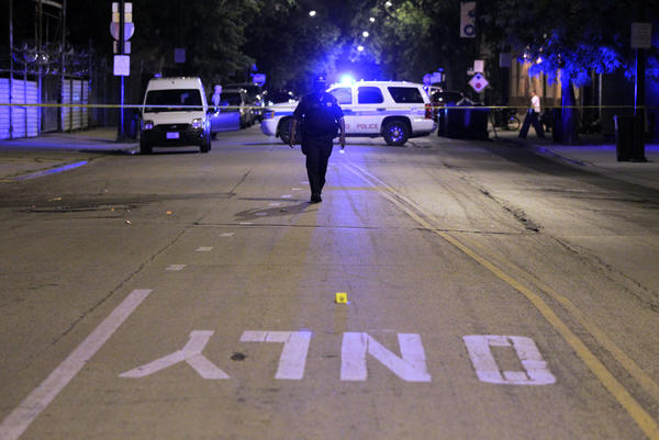 Chicago Police investigate the scene of a shooting at Harrison St. and California Ave. in Chicago on Sunday.