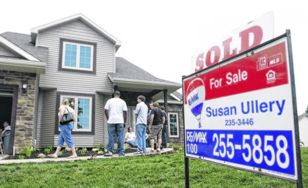 Neighbors and friends gather at the house built and recently sold by South Bend Schools building trades, on Friday, May 31, 2013, in Nature's Gate Subdivision in South Bend.