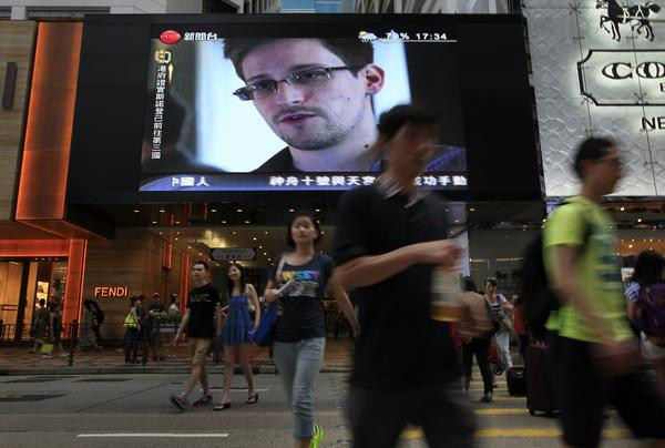 A TV screen at a Hong Kong shopping mall shows a news report on Edward Snowden.