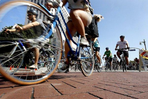 CicLAvia participants ride through downtown Los Angeles during the last such event in April.