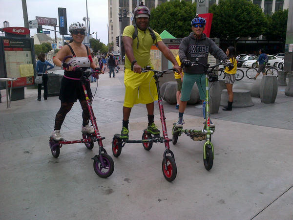 Monica Jeffries, 40, of Canyon Country in Santa Clarita; Quincy Jeffries, 42, of Canyon Country; and their friend. Dennis Hauswirth, 62, of Brentwood, get ready to ride their trikkes in Ciclavia on Wilshire Boulevard.