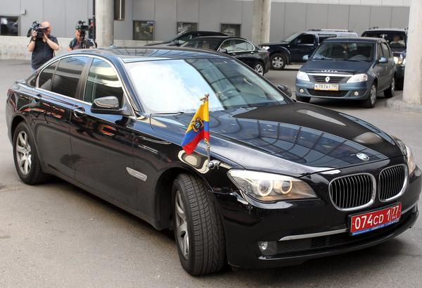 A diplomatic car from the Ecuador Embassy in Russia stands at Sheremetyevo airport in Moscow on Sunday. Edward Snowden, the former contractor for the U.S. National Security Agency, arrived in Moscow from Hong Kong and has reportedly asked for asylum in Ecuador.