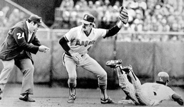 Bobby Grich tags Paul Molitor out trying to steal second base in 1982.