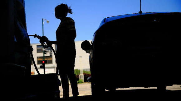 A Chicago woman fills up at BP station at Marine Drive and Lawrence Avenue earlier this month.