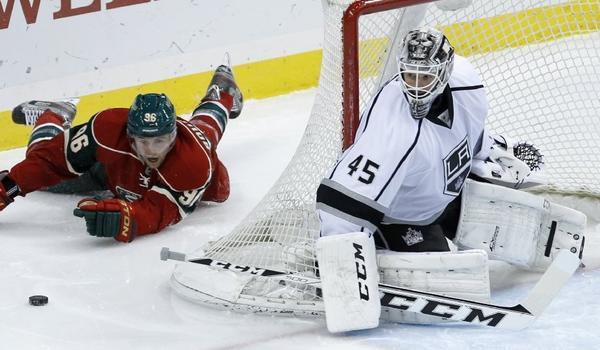The Kings traded backup goalie Jonathan Bernier to the Toronto Maple Leafs in exchange for forward Matt Frattin, goaltender Ben Scrivens and a draft pick.