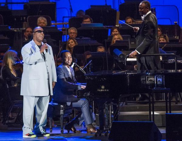 Stevie Wonder, left, and John Legend perform at the Hollywood Bowl, backed by the Hollywood Bowl Orchestra under the baton of Thomas Wilkins.