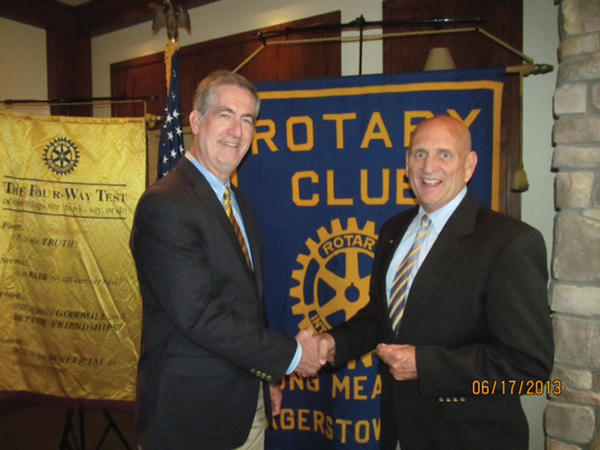 Terry Irwin, left, is welcomed as speaker by club President Ron Bowers at a recent meeting of the Rotary Club of Long Meadows.