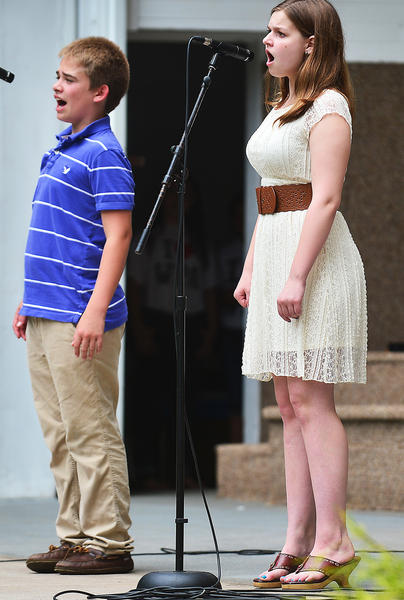 Patrick Prunty, 14, and Addison Prosser, 14, both of Hagerstown, sing Sunday at the band shell in Hagerstown's City Park while performing with Walker Performing Arts and Hagerstown Children's Theater during Arts in the Park.