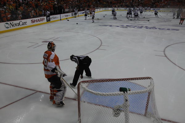 Linesman Steve Miller grabs the puck as Flyers goalie Michael Leighton watches at the end of Game 6 as the Blackhawks beat the Flyers 4-3 to win the Stanley Cup Cup in 2010.