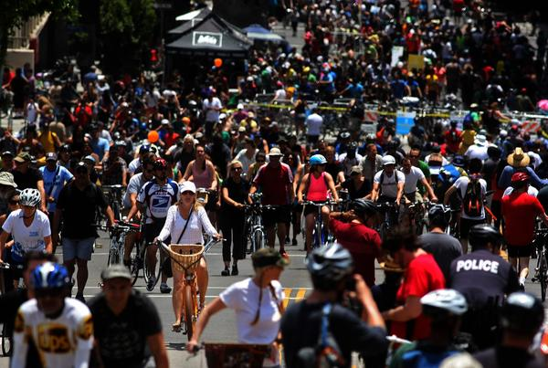 Hordes of cyclists make their way along Wilshire Boulevard near downtown Los Angeles.
